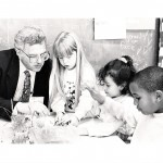 Bruce explaining energy and light to Spring Valley School first graders Casey Harper, Justina Cardenas and Jamal Parsons, for the UCSF SEP program, while Biochem Department Chair, 1992.